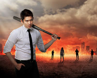 Man in white shirt holding baseball bat. Asian man in white shirt and tie holding baseball bat Stock Photo