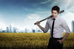 Man in white shirt holding baseball bat. Asian man in white shirt and tie holding baseball bat Stock Photos
