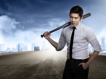Man in white shirt holding baseball bat. Asian man in white shirt and tie holding baseball bat Royalty Free Stock Image