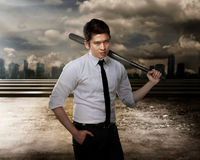Man in white shirt holding baseball bat. Asian man in white shirt and tie holding baseball bat Royalty Free Stock Photos