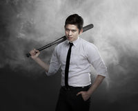 Man in white shirt holding baseball bat. Asian man in white shirt and tie holding baseball bat Royalty Free Stock Images