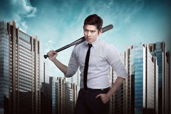 Man in white shirt holding baseball bat. Asian man in white shirt and tie holding baseball bat Stock Photography