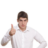 Man in white shirt. Lifted thumb isolated on white background stock photography