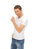 Man in white shirt making inviting gesture Royalty Free Stock Image