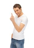 Man in white shirt making inviting gesture Royalty Free Stock Photo