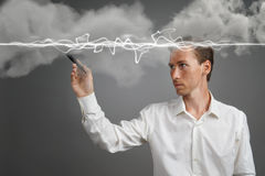 Man in white shirt making magic effect - flash lightning. The concept of electricity, high energy. Stock Photo