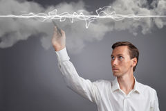 Man in white shirt making magic effect - flash lightning. The concept of electricity, high energy. Royalty Free Stock Photos