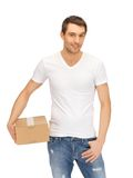 Man in white shirt with parsel Royalty Free Stock Photos