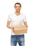 Man in white shirt with parsel Stock Photography