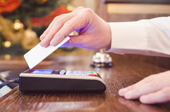 Man in white shirt paying bill with blank white contactless wave. Caucasian male in white shirt paying bill with contactless credit card Royalty Free Stock Image