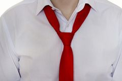 A man in a white shirt and red tie, tie is not tied up, close-up, businessman royalty free stock photos