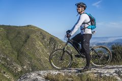 Man With White Shirt Riding Abicycle on a Mountain Stock Photos