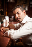 Man in white shirt sitting near bar desk. Closeup portrait of man in white shirt sitting near bar desk Stock Photos