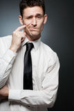Man in white shirt thinking of the great idea. Royalty Free Stock Images