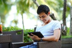 Man in White Shirt Using Tablet Computer Shallow Focus Photography Stock Photos