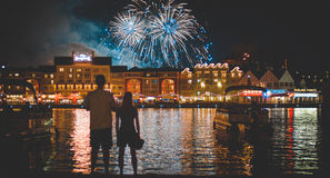 Man in White Shirt Beside Woman Watching Fire Works during Night Time Royalty Free Stock Photo