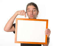 Man with white signboard Royalty Free Stock Image