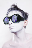 Man with white skin in strange violet glasses Stock Photos