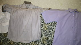 Man white and striped shirts lie on sofa stock footage