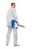 Man in white suit with electric guitar look back Royalty Free Stock Image