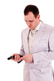 Man in white suit reload the gun Stock Images