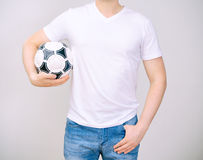 Man in white t-shirt with ball. Royalty Free Stock Image
