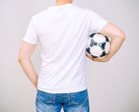 Man in white t-shirt with ball. Royalty Free Stock Photo