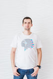Man in white T-shirt and blue jeans on a white background Royalty Free Stock Photos