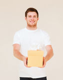 Man in white t-shirt with gift box Stock Photo