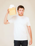 Man in white t-shirt with gift box Royalty Free Stock Photography