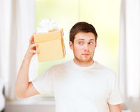Man in white t-shirt with gift box Royalty Free Stock Images