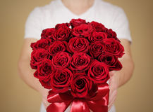 Man in white t shirt holding in hand rich gift bouquet of 21 red Royalty Free Stock Images