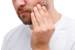 A man holds on to a sick tooth. Stock Photo
