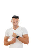 Man in white t-shirt pointing a finger at clock to camera Stock Photography