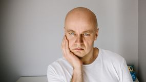 Man in white t-shirt suffers from toothache. Stock Images