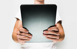 Man in white t-shirt using tablet pc Royalty Free Stock Images