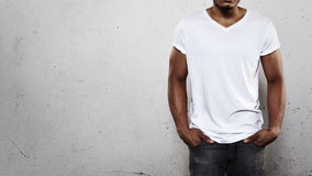 Man in white t-shirt. Young african man wearing white blank t-shirt stock photo
