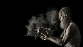 Man in White Tank Top Holding Book stock photo