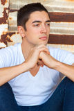 Man In White Tee Shirt. A male in his mid 20's sits in a boxcar that is old and decaying in a white t-shirt with nothing on it Royalty Free Stock Image