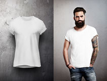 Man and white tshirt on grey background Stock Photo