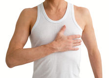 Man in white undershirt with hand on his heart. Man in undershirt with hand on his heart isolated on white background royalty free stock photos
