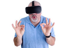 Man on white wearing virtual reality glasses Royalty Free Stock Images