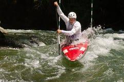 Man in a whitewater kayak Stock Image
