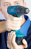 Man whith screwdrivers. Man whith a blue screwdrivers Royalty Free Stock Photography