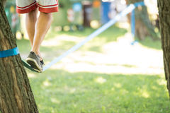 Man who came up on Slackline. In the park royalty free stock photo