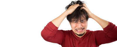 Man who can not solve his problems. Asian man in red t-shirt has too much stress and problem. Isolated white background Stock Photo
