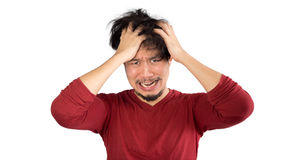 Man who can not solve his problems. Asian man in red t-shirt has too much stress and problem. Isolated white background Royalty Free Stock Photography