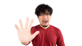Man who can not solve his problems. Asian man in red t-shirt has too much stress and problem. Isolated white background Royalty Free Stock Photos