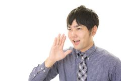 Smiling Asian businessman. Man who is cheering isolated on white background Royalty Free Stock Photo