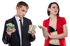 Man who doesn't know how to pay a woman. Isolated photo of people with white background Royalty Free Stock Photos